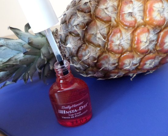 Sally Hansen Insta-Dri anti-chip top coat and a pineapple